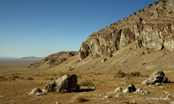 A barren Great Basin landscape where native vegetation was replaced by the fire-prone invasive Cheatgrass.