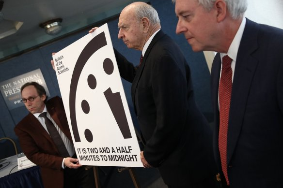 "Members of the Bulletin of Atomic Scientists unveil the 2017 time for the ""Doomsday Clock"" January 26, 2017 in Washington, DC. For the first time in the 70-year history of the Doomsday Clock, the Bulletin of Atomic Scientists moved the clock forward 30 seconds to two and a half minutes before midnight, citing ""ill-considered"" statements by U.S. President Donald Trump on nuclear weapons and climate change, developments in Russia, North Korea, India and Pakistan. From left to right are theoretical physicist Lawrence Krauss, former U.S. Ambassador to the United Nations Thomas Pickering and retired U.S. Navy Rear Admiral David Titley. (Photo by Win McNamee/Getty Images)"