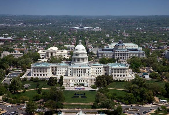 United States Capitol Building, Washington, D.C. Aerial. The United States Capitol is the meeting place of the United States Congress, the legislature of the Federal government of the United States. Located in Washington, D.C., it sits atop Capitol Hill at the eastern end of the National Mall.